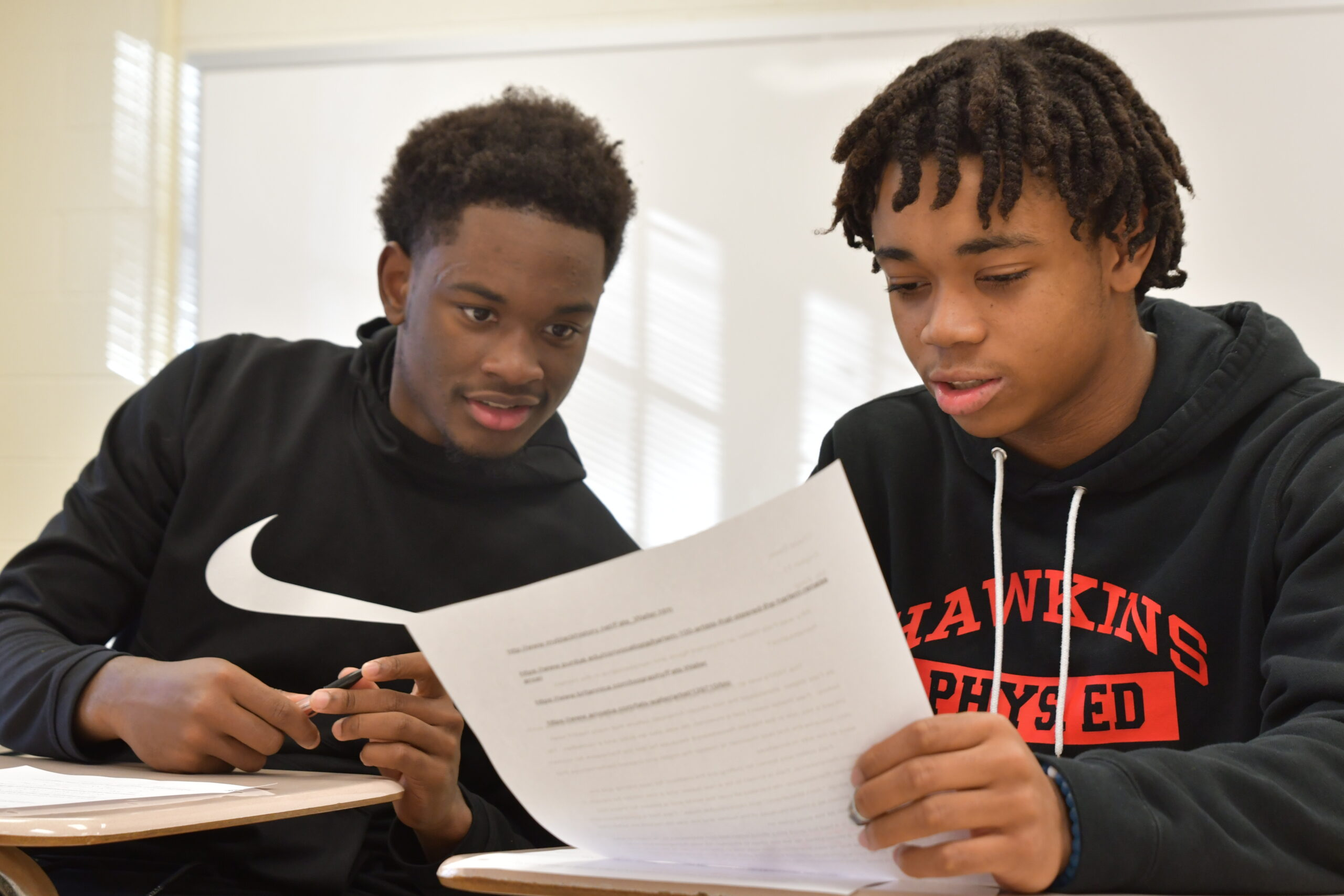 Two students look at an essay
