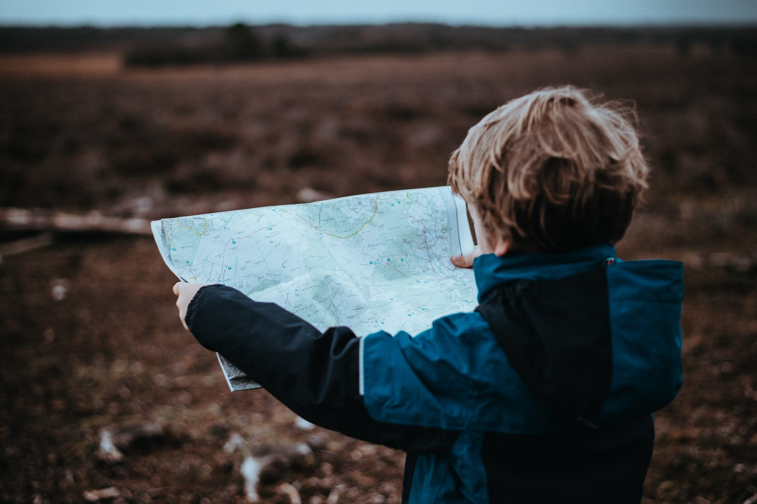 Child looks at map